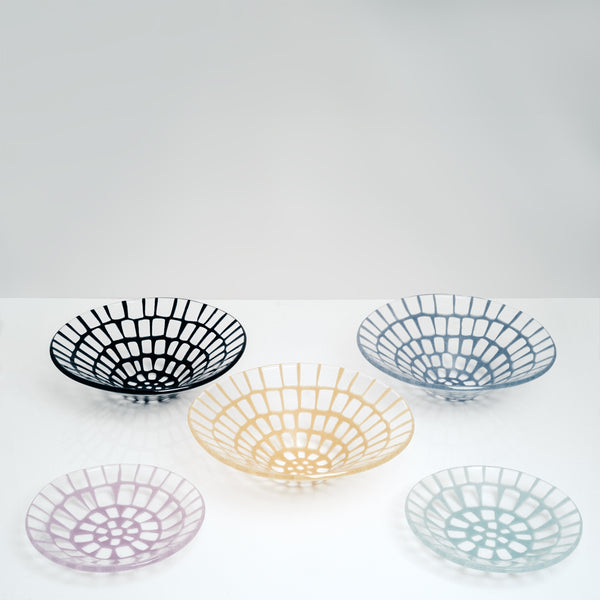 A collection of five Saburo Afumi artisanal glassware pieces — three large conical bowls and two small dishes, all made in Japan. Each is transparent with a windowed pattern in a vibrant colour — Navy blue, yellow and cornflower blue for the fruit bowls, pink and mint blue for the dishes.