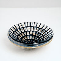Three Saburo Afumi large conical glass bowls, each with a vibrantly coloured grid pattern — yellow at the bottom, cornflower blue in the center and navy blue at the top. All made in Japan and sold at NiMi Projects UK.