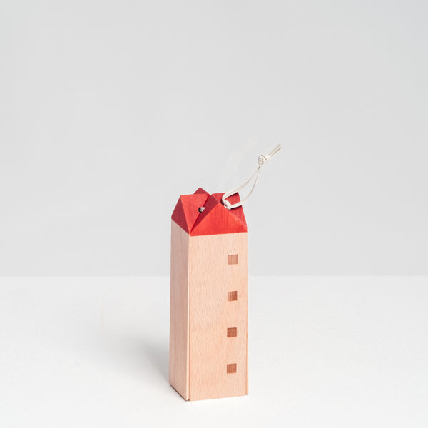 Special-edition SunaoLab wooden house trivet with pattern of four windows, a red roof and white hanging cord, made in Japan and available at NiMi Projects UK.