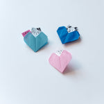 Japanese origami paper heart pockets, two blue and one pink, each with a little cat peeking out, made at the NiMi Projects Valentine's workshop