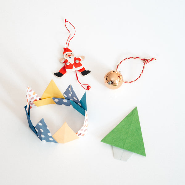 Get ready with fun party hats in vibrant patterns. This modular origami crown can be adjusted to any size — simply add extra triangles to make it bigger or take one away for a snugger fit.  Join NiMi Projects online to learn how to make them!