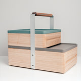 The two-tiered and handled wooden Okamochi Box by Atelier Yocto — the perfect picnic basket, tool box or stunning home storage case. Made in Japan and available at NiMi Projects, UK.