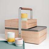 Hand crafted in Japan by Atelier Yocto, the wood Okamochi Box is versatile — double tiered with a removable top case, perfect as a picnic hamper, trug or home storage. Available at NiMi Projects, UK.