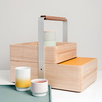 The two-tiered wooden Okamochi Box is made in Japan by Atelier Yocto. It's removable box and tray lid makes it ideal for picnics and home storage. Find it at NiMi Projects,  UK.