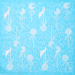 Sky blue Japanese furoshiki wrapping cloth with a pattern of dandelion seed heads, designed by Takehisa Yumeji