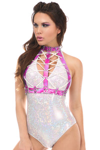 A lady wearing a festival bodysuit in white with a dark pink holographic lace up chest harness with white front lacings.