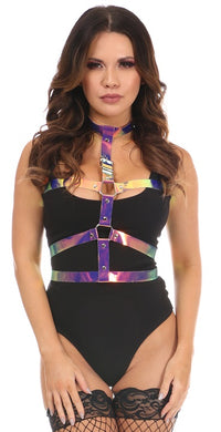 A tall brunette female wearing a black bodysuit is showing off a purple iridescent body harnes that straps around the neck, around the check and under the chest connecting at the front.