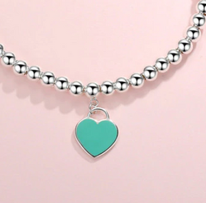 Sterling Silver with Dangling Tiffany Blue Heart Bead Bracelet
