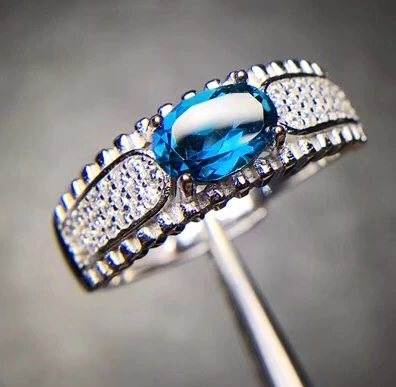 Bonny 0.76 Carat Oval Blue Topaz & Cubic Zirconia Sterling Silver Ring, Blue Topaz, Blue Topaz Ring, Blue Topaz Birthstone, Blue Topaz Birthstone Ring, Blue Topaz and Sterling Silver, Birthday Ring, December Birthstone, December Birthstone Ring, 100Sterling.com
