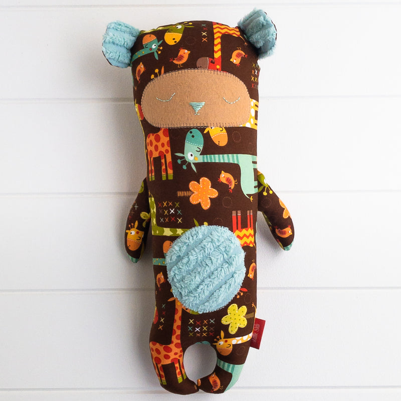 Peg Bear - Giraffe on Brown fabric