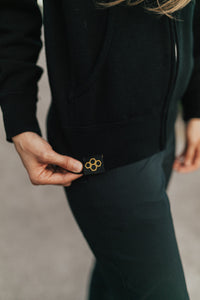 WOMEN'S GLOBAL BADGE  ZIP HOODIE