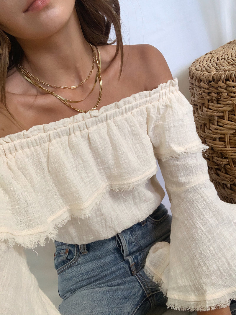 Cream off the shoulder crop top with flowy sleeves