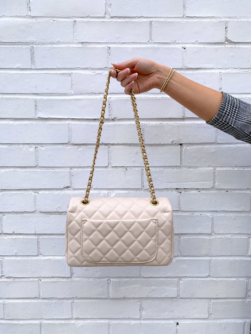 Cream quilted faux leather shoulder bag with gold hardware detailing and chain strap with back pocket