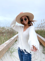 Womens white distressed and frayed v-neck reversible sweater