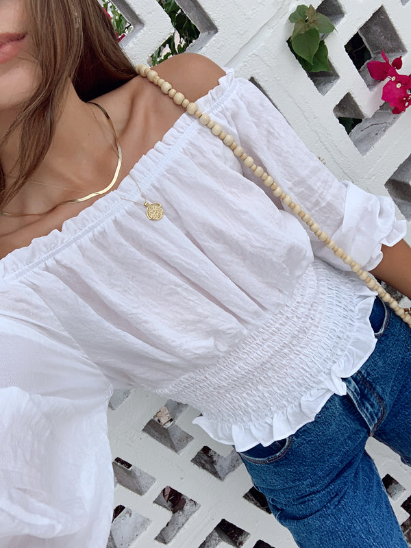 white off the shoulder smocked top