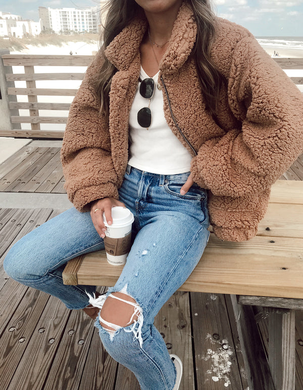 Oversized brown fuzzy teddy coat with front zipper and two pockets