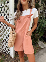 Womens pink overalls with two front pockets and two shoulder ties