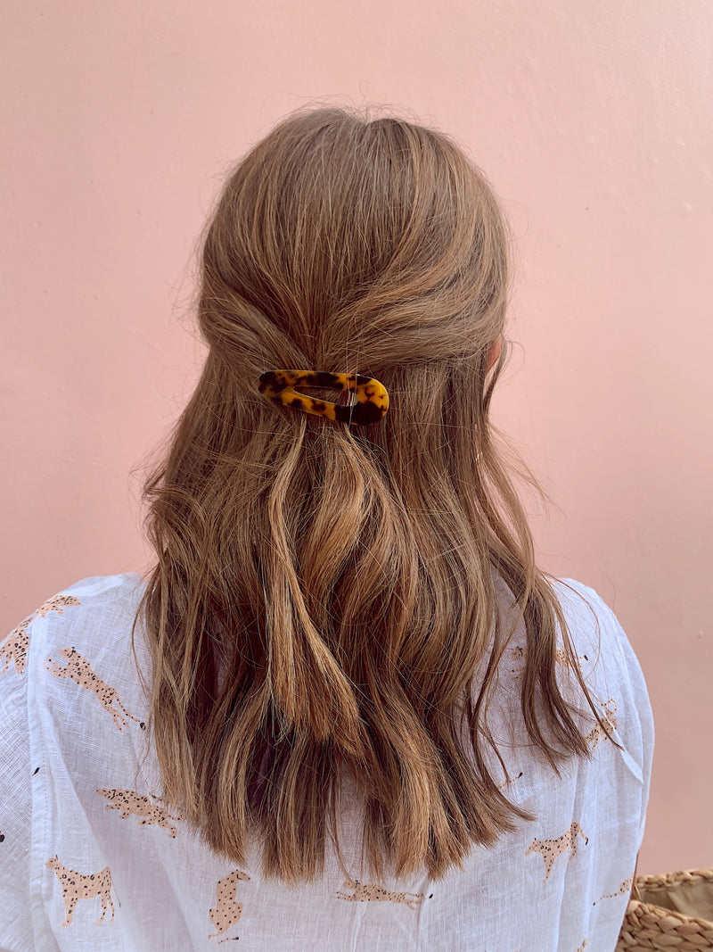 Womens tortoise hair barrettes in hair