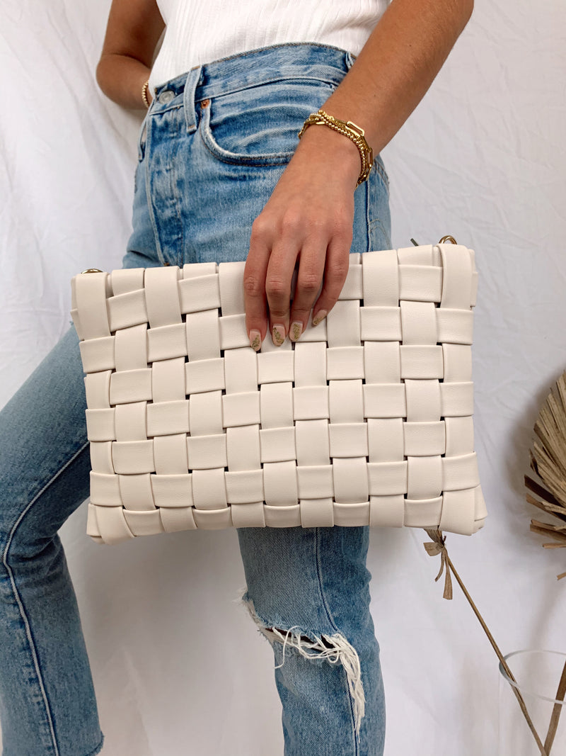 ivory leather braided clutch