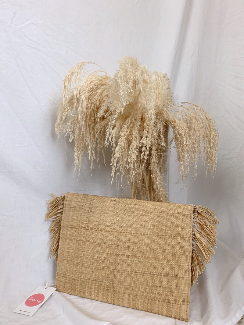 boho straw clutch with fringe