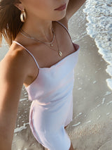 Blush satin slip mini dress with cowl neckline and low back