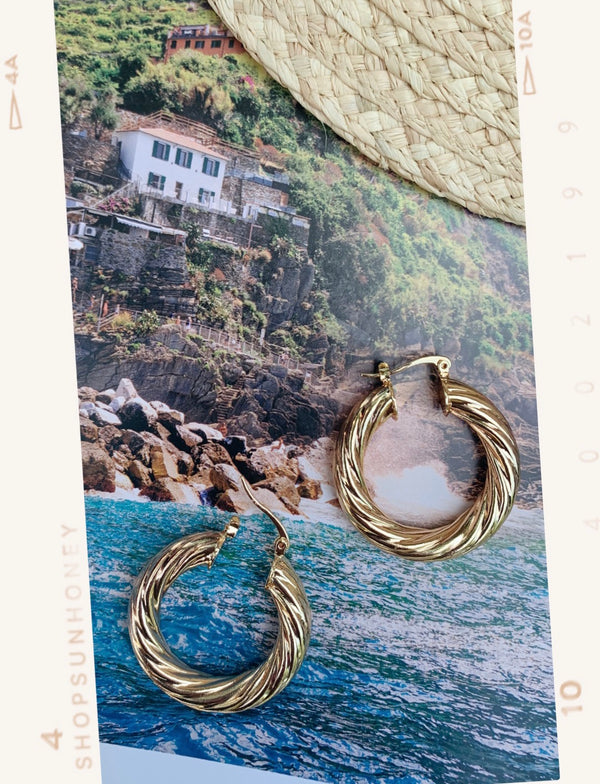 Medium size, gold twisted style hoop earrings