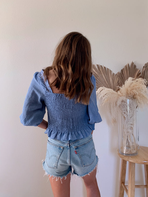 womens blue smocked long sleeve crop top