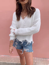 white womens distressed hemmed sweater