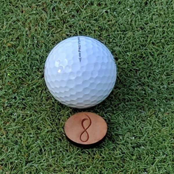 Cherry Wood Ball Marker on the Green