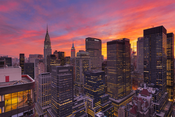 Fire in the sky over New York City during sunset by Kirit Prajapati