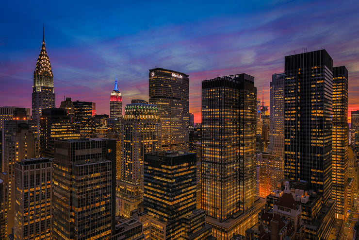 New York City with the Empire State Building lit in Red White and Blue at sunset by Kirit Prajapati