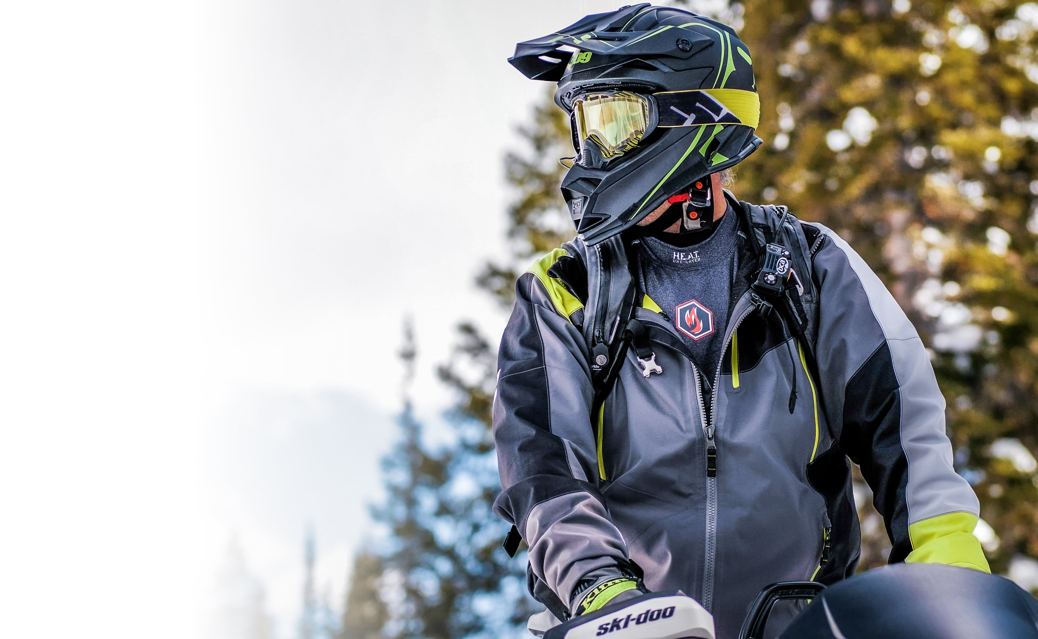Guy on snow mobile wearing H.E.A.T. One-Layer