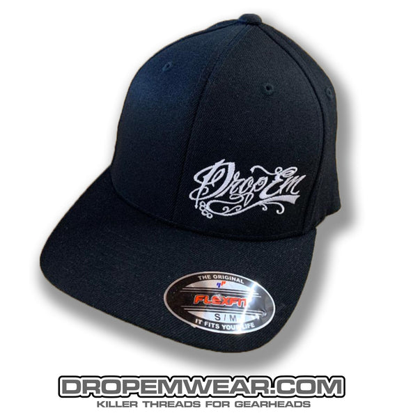 BLACK CURVED BILL FLEX FIT HAT WITH WHITE TATTOO SCRIPT LEFT PANEL