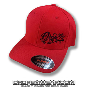 RED CURVED BILL FLEX FIT HAT WITH BLACK SCRIPT LOGO