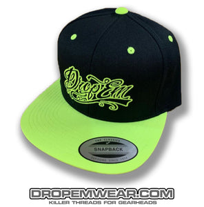 BLACK FLAT BILL SNAP BACK WITH NEON YELLOW BILL AND NEON YELLOW TATTOO SCRIPT LOGO