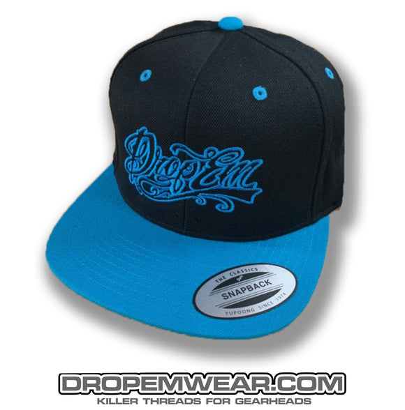BLACK FLAT BILL SNAP BACK WITH NEON BLUE BILL AND NEON BLUE TATTOO SCRIPT LOGO