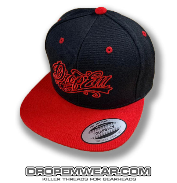 BLACK FLAT BILL SNAP BACK WITH RED BILL AND RED TATTOO SCRIPT LOGO