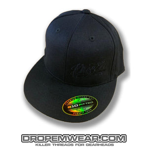 BLACK FLAT BILL FLEX FIT HAT WITH BLACK SCRIPT LOGO ON LEFT PANEL