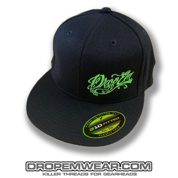 BLACK FLAT BILL FLEX FIT HAT WITH LIME SCRIPT LOGO ON LEFT PANEL