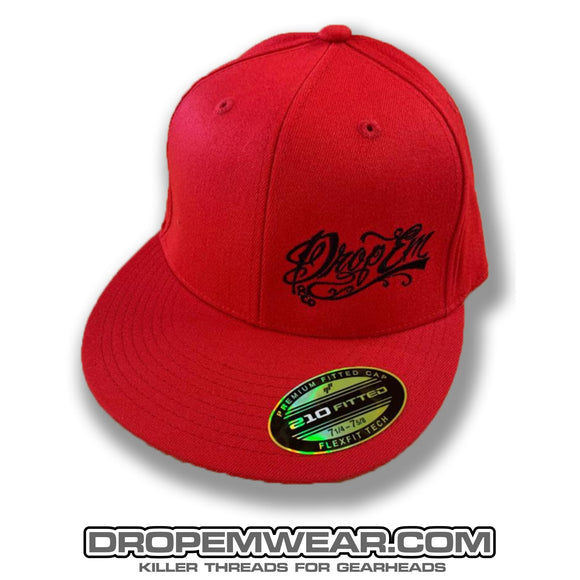RED FLAT BILL FLEX FIT HAT WITH BLACK SCRIPT LOGO ON LEFT PANEL