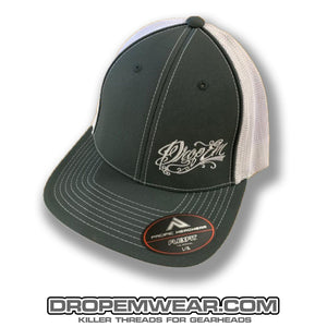 PACIFIC HEADWEAR CURVED BILL FITTED TRUCKER HAT GRAPHITE/WHITE WITH TATTOO SCRIPT LOGO ON LEFT PANEL