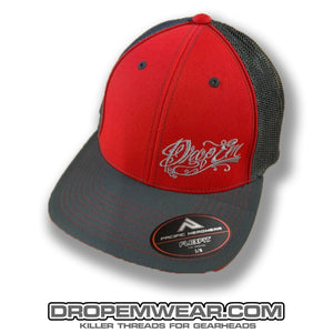 PACIFIC HEADWEAR CURVED BILL FITTED TRUCKER HAT RED/GRAPHITE WITH TATTOO SCRIPT LOGO ON LEFT PANEL
