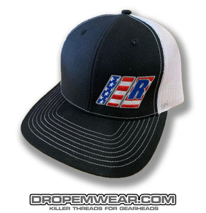 RELAXED AMERICAN FLAG BARS AND R LOGO ON BLACK/WHITE SNAP BACK TRUCKER