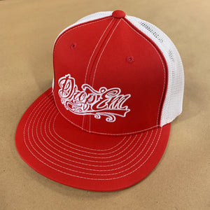 PACIFIC HEADWEAR FLAT BILL FITTED TRUCKER HAT RED/WHITE WITH TATTOO SCRIPT LOGO ON LEFT PANEL