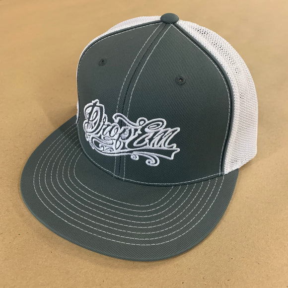 PACIFIC HEADWEAR FLAT BILL FITTED TRUCKER HAT GRAPHITE/WHITE WITH TATTOO SCRIPT LOGO ON LEFT PANEL