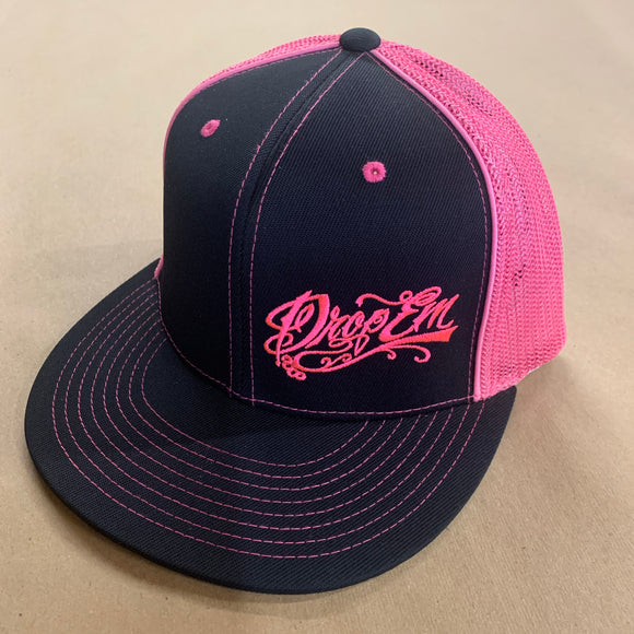 PACIFIC HEADWEAR FLAT BILL FITTED TRUCKER HAT NEON PINK/BLACK WITH TATTOO SCRIPT LOGO ON LEFT PANEL