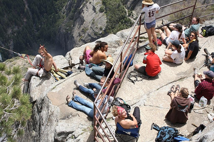 A group of slackliners at the top of Yosemite Falls