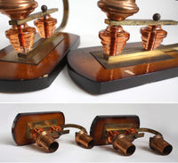 Pair of 1950s candleholders, dark wood, peach glass, brass