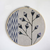 Modern blue embroidered silk screen print wall hanging in hoop