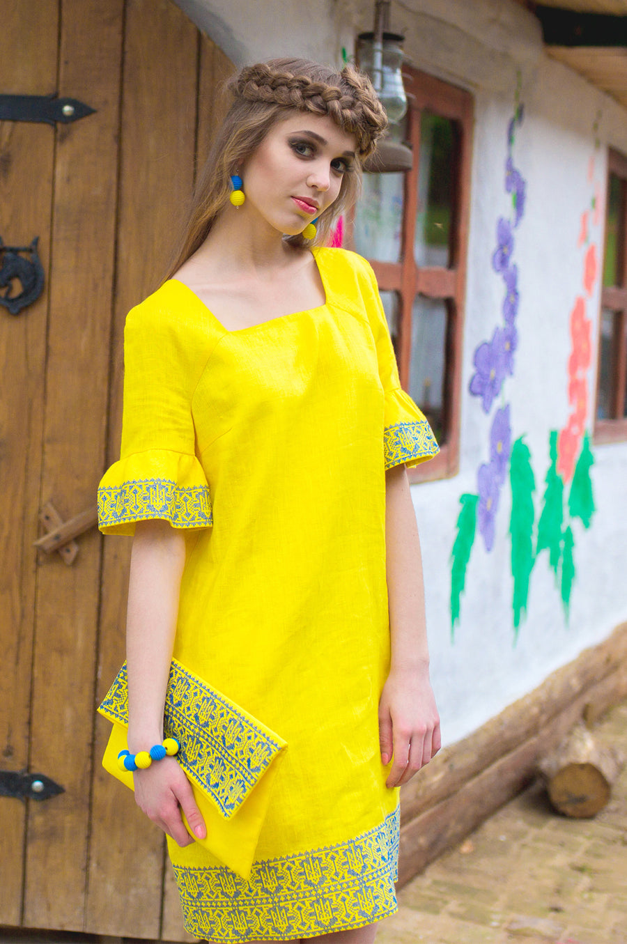 The dress is yellow with embroidery in the national style